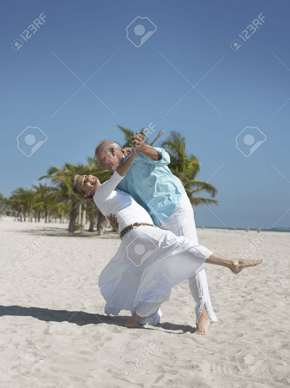 Couple Dancing on the Beach Stock Photo - 5478605