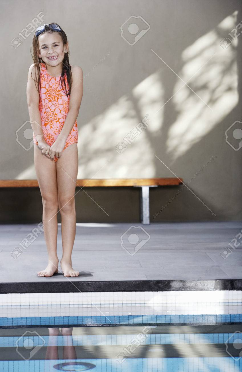 youngster girls Stock Photo - Young Girl Standing By the Pool