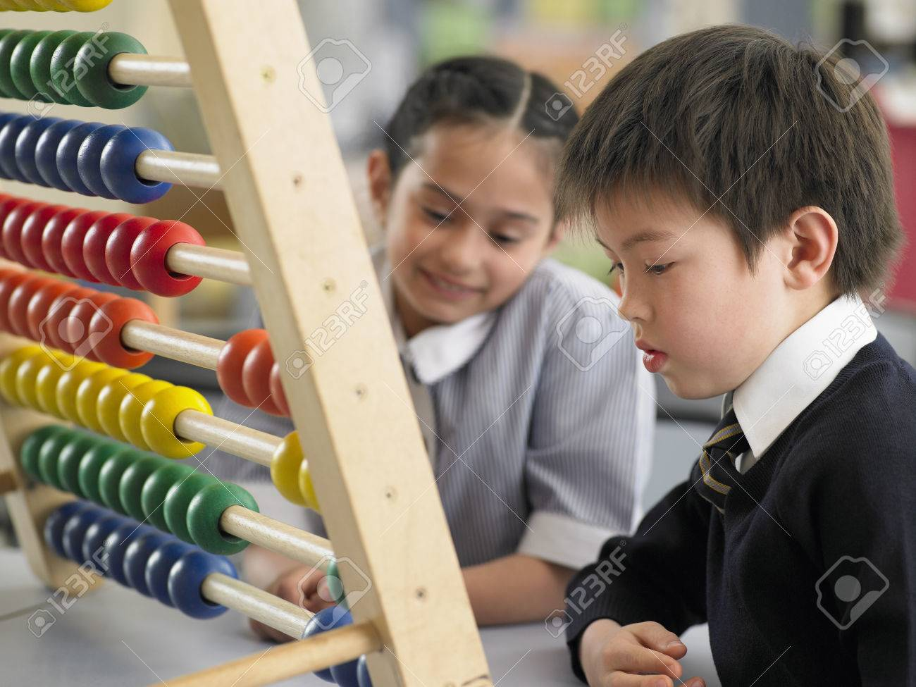 Schoolkids Using an Abacus Stock Photo - 5487624
