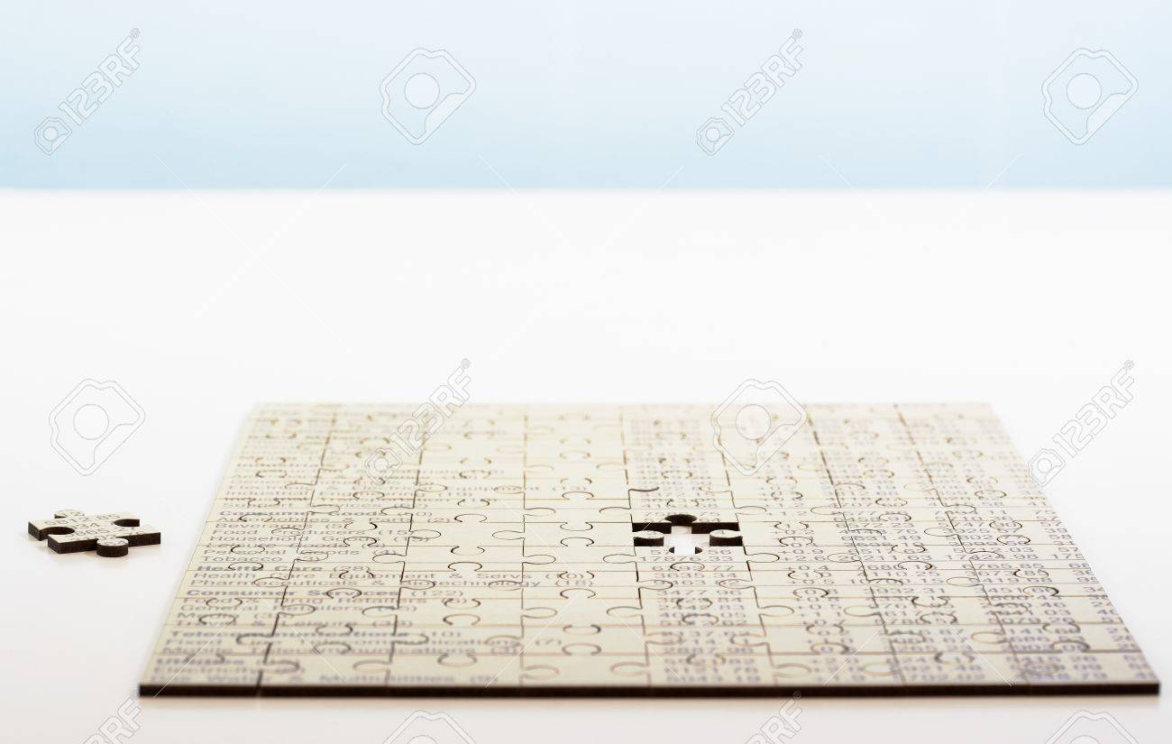 Business Puzzle with One Last Piece Needed Stock Photo - 5487787