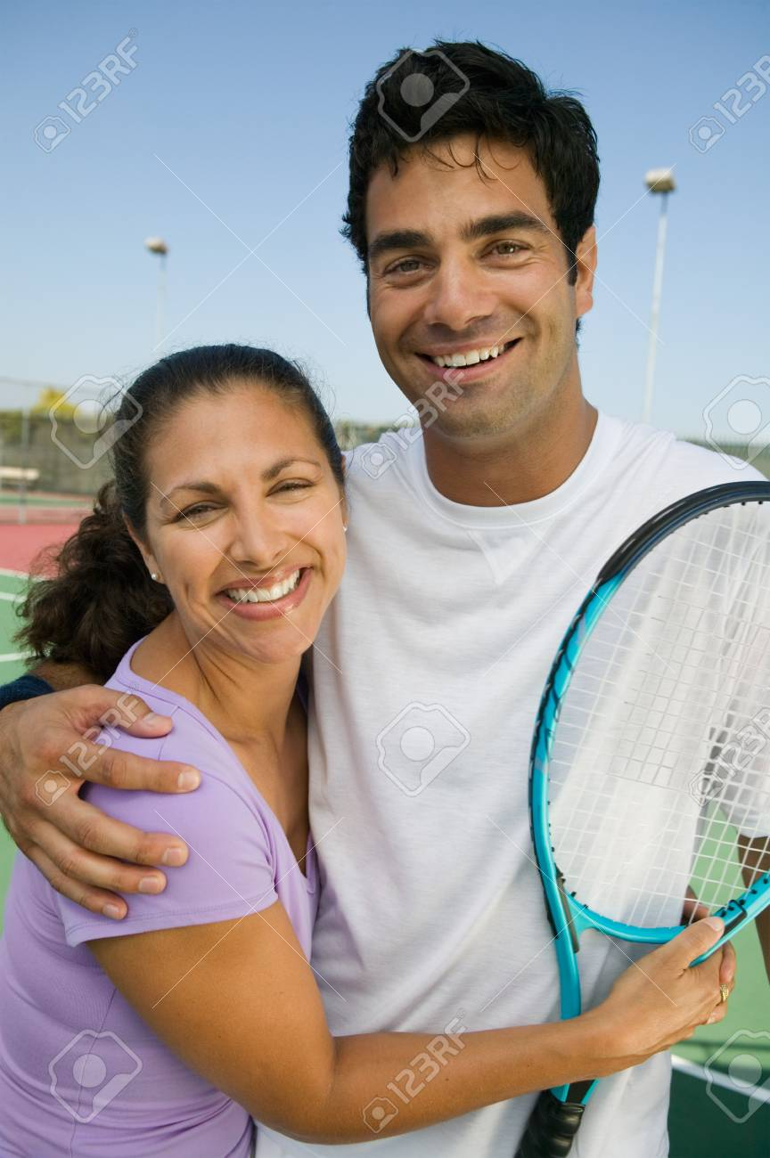 Mixed doubles Tennis Players on tennis court portrait Stock Photo - 8822776