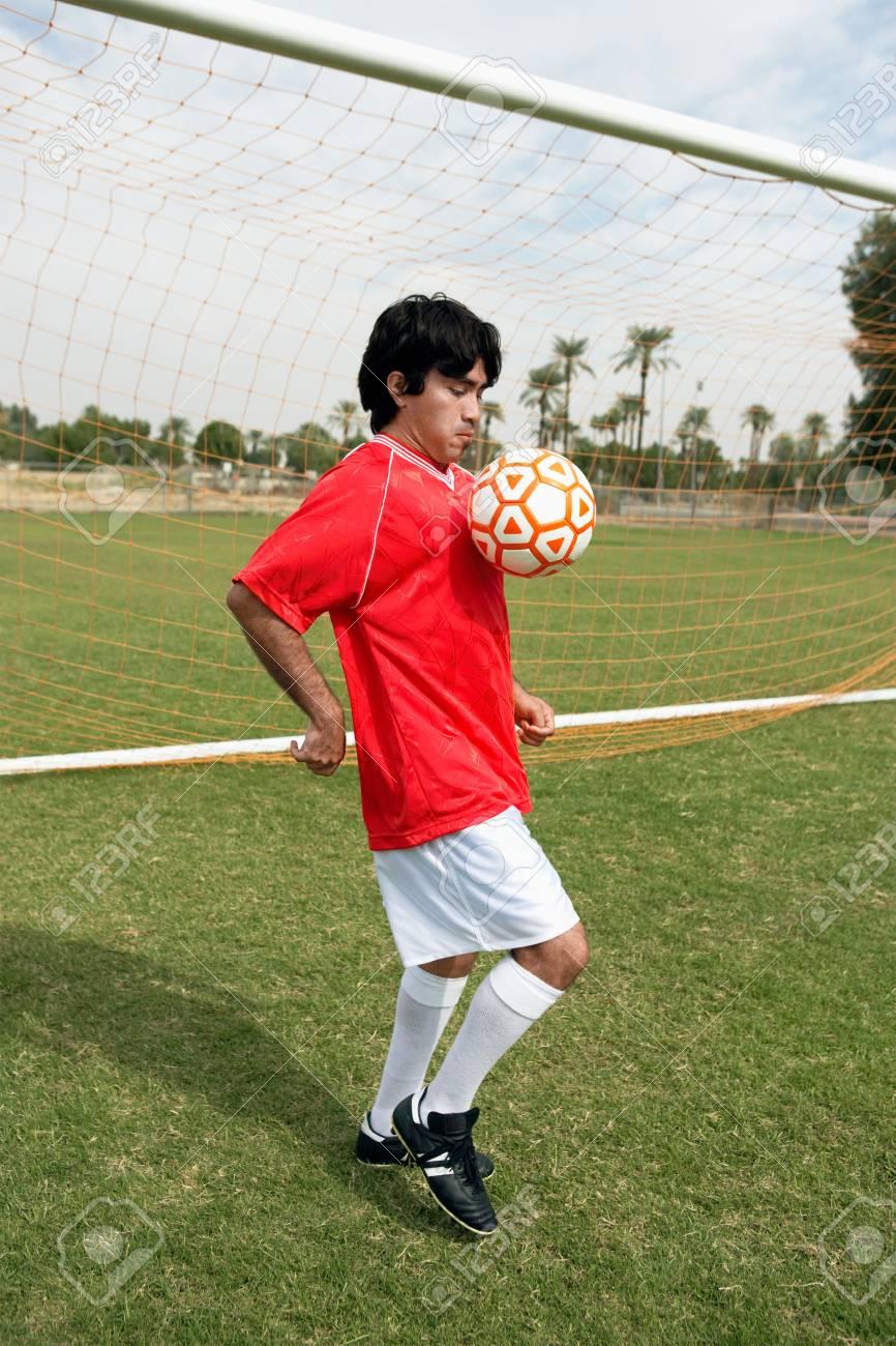 Soccer player juggling ball portrait Stock Photo - 8836551