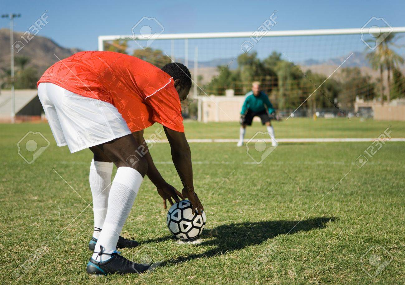 Soccer player preparing for penalty kick back view Stock Photo - 8836578