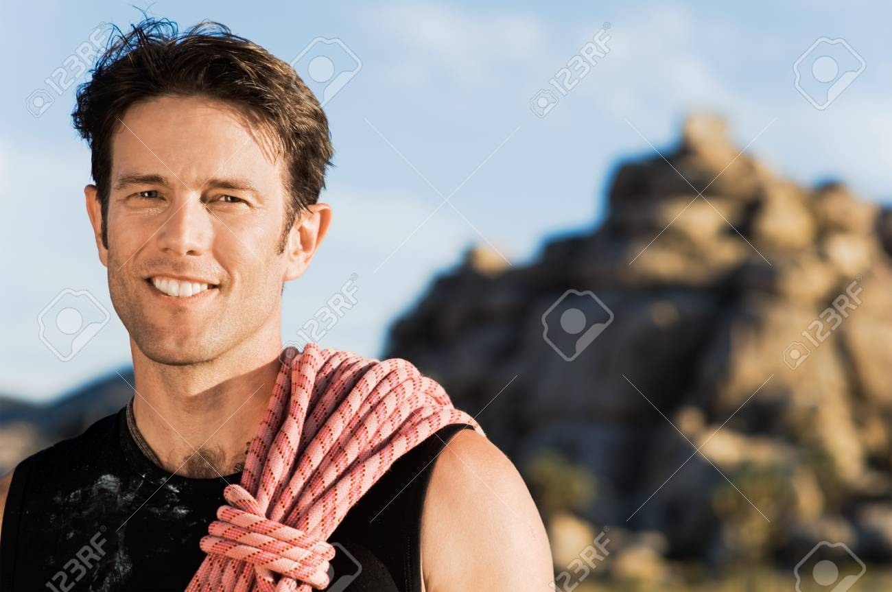 Rock climber with Rope on Shoulder (portrait) Stock Photo - 8837101
