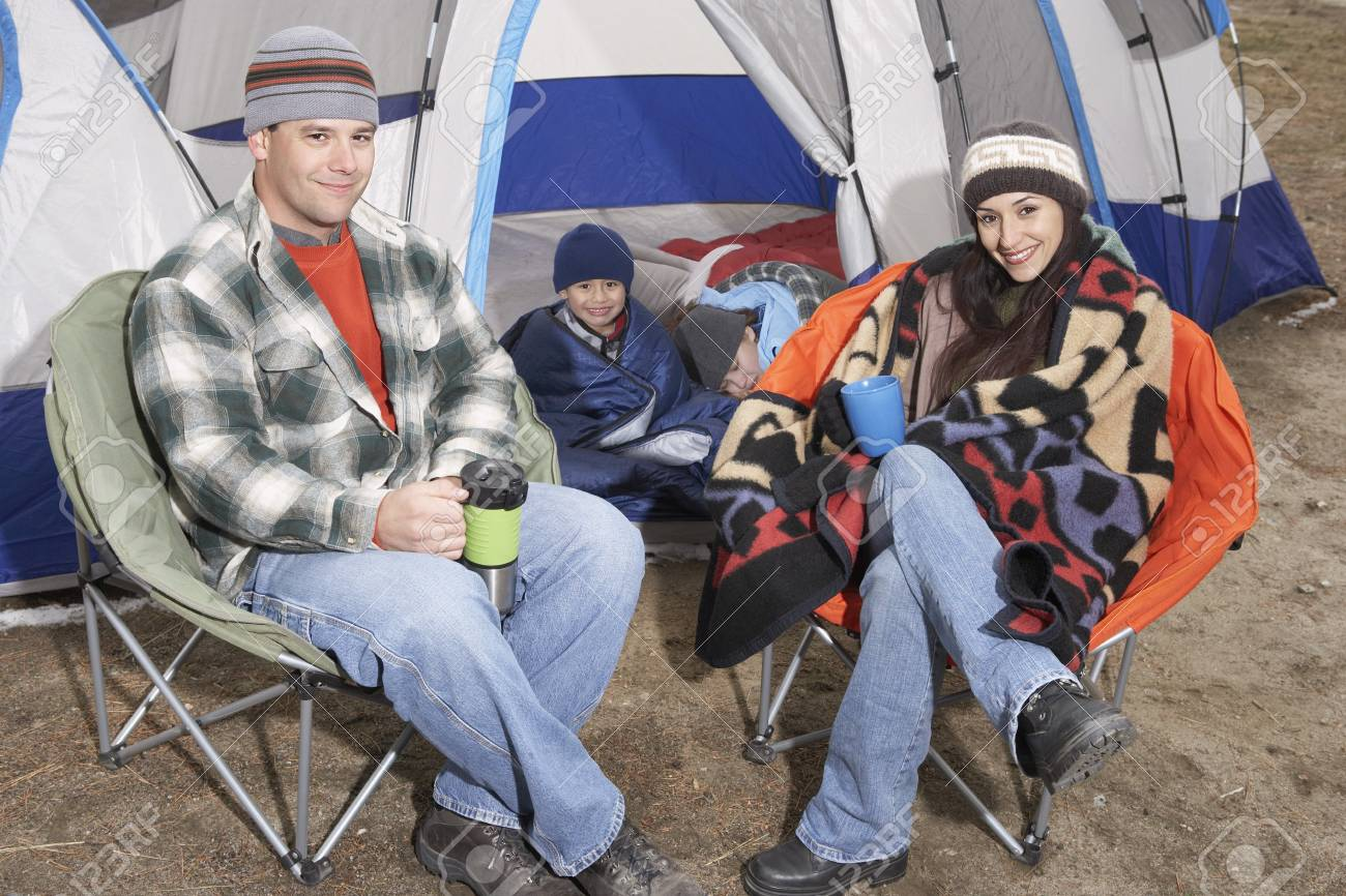 Family with children (7-12) camping (portrait) Stock Photo - 8844508