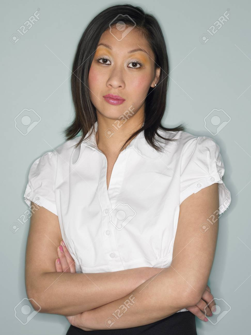 Woman with Arms Crossed in studio half-length Stock Photo - 8844563