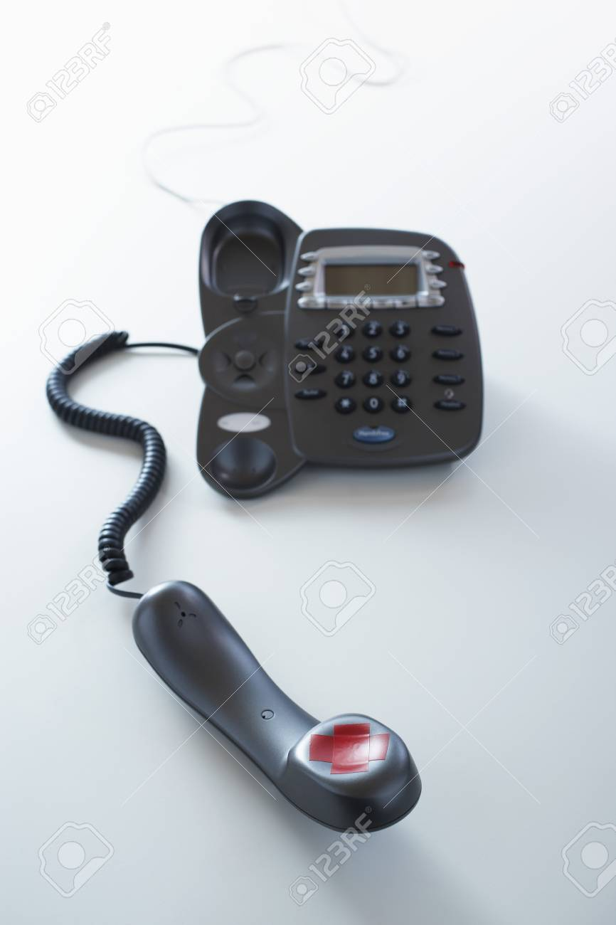 Telephone red tape forming letter x on receiver Stock Photo - 8844607