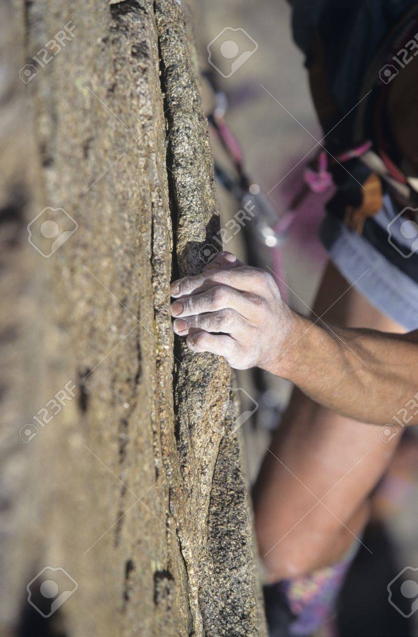 Rock Climber holding on to cliff close-up Stock Photo - 8844831