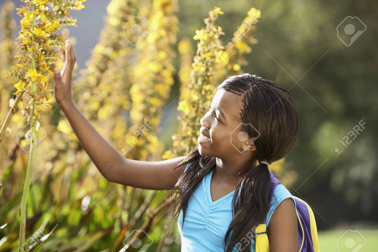 Girl Looking at Flowers Stock Photo - 8844881