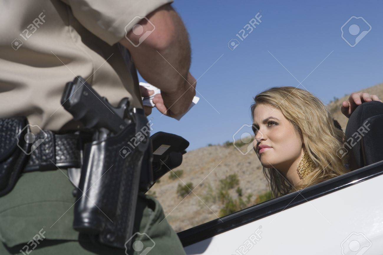 Armed police officer apprehends female driver Stock Photo - 12513773