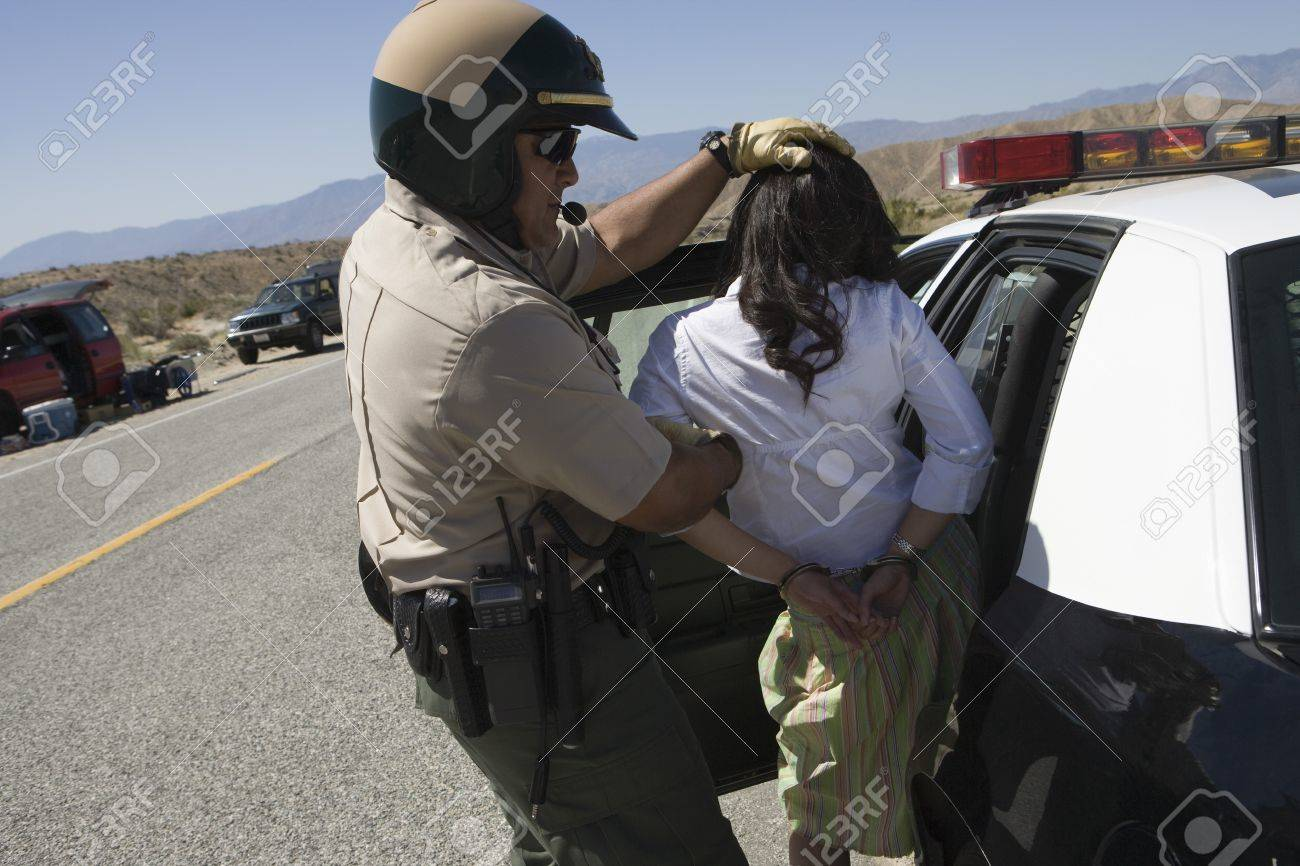Police officer arrests female driver Stock Photo - 12513812