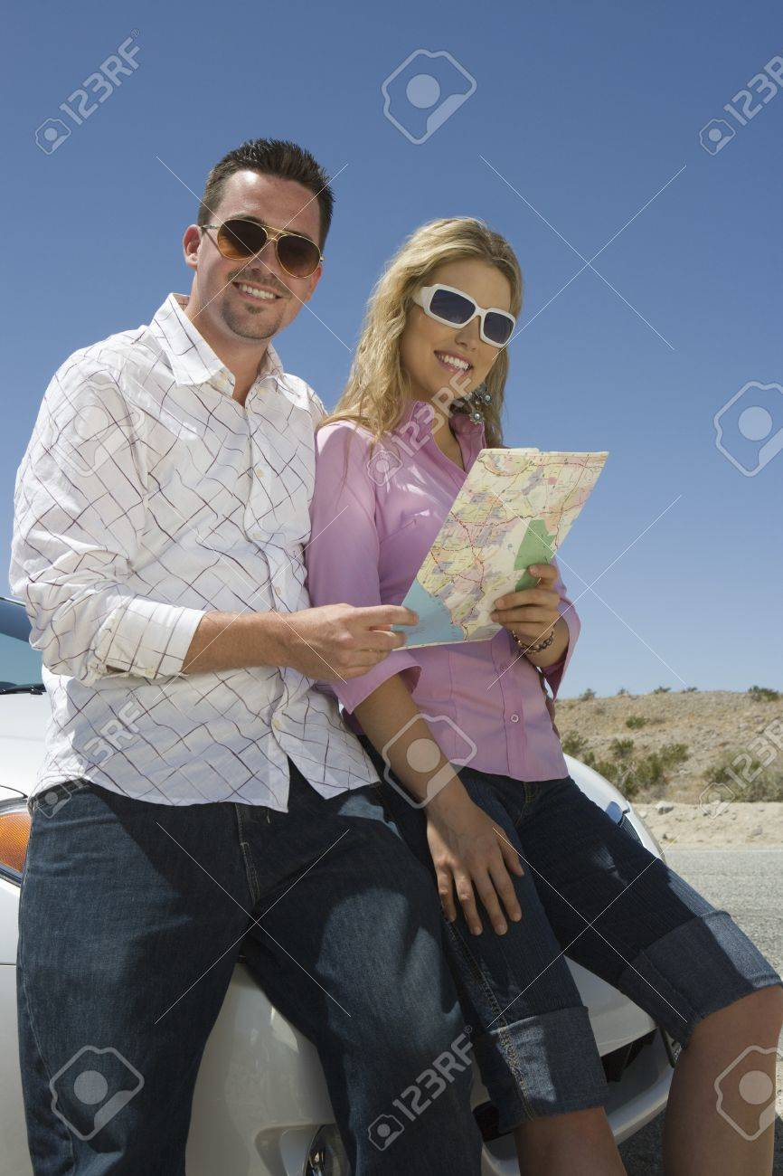 Couple with map leaning on car Stock Photo - 12513834