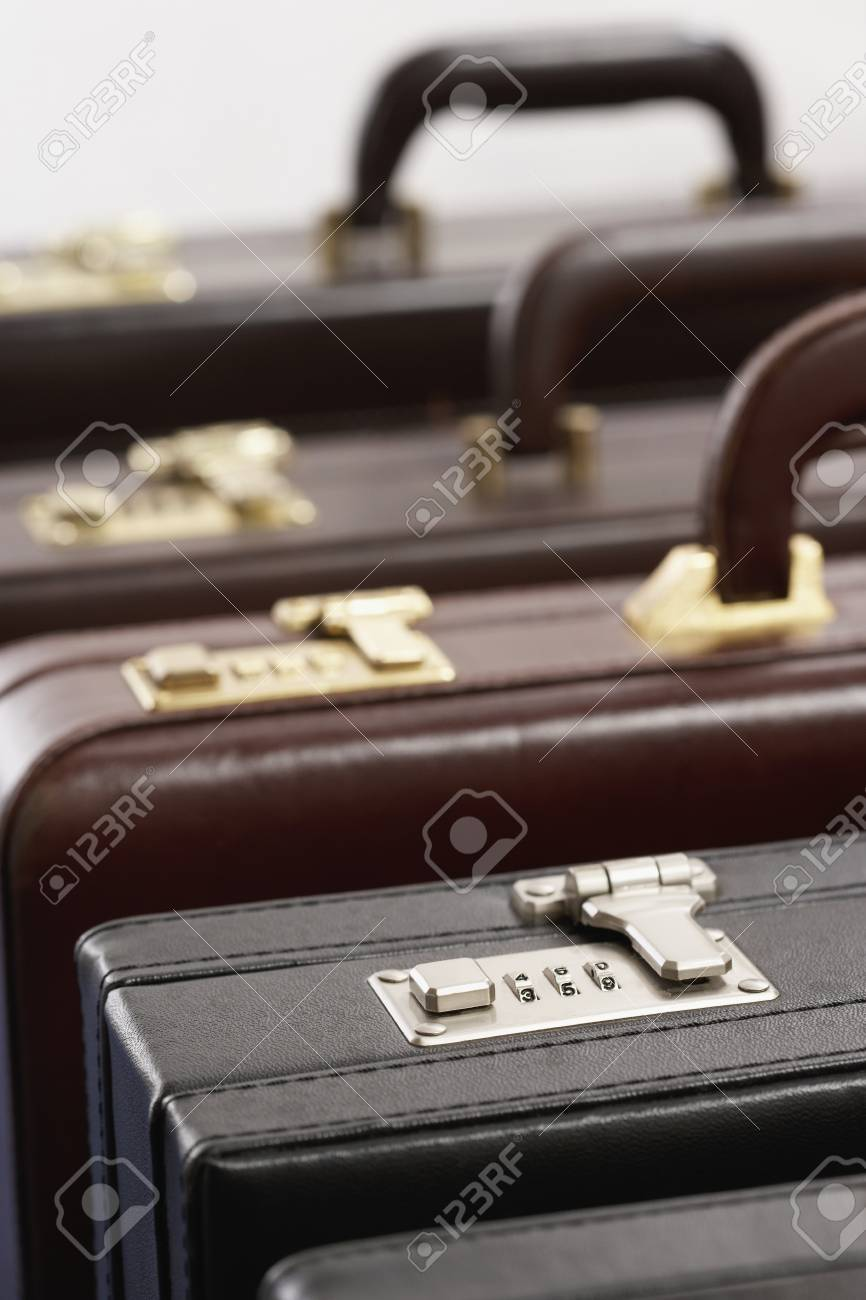 Row of briefcases in studio Stock Photo - 12514090