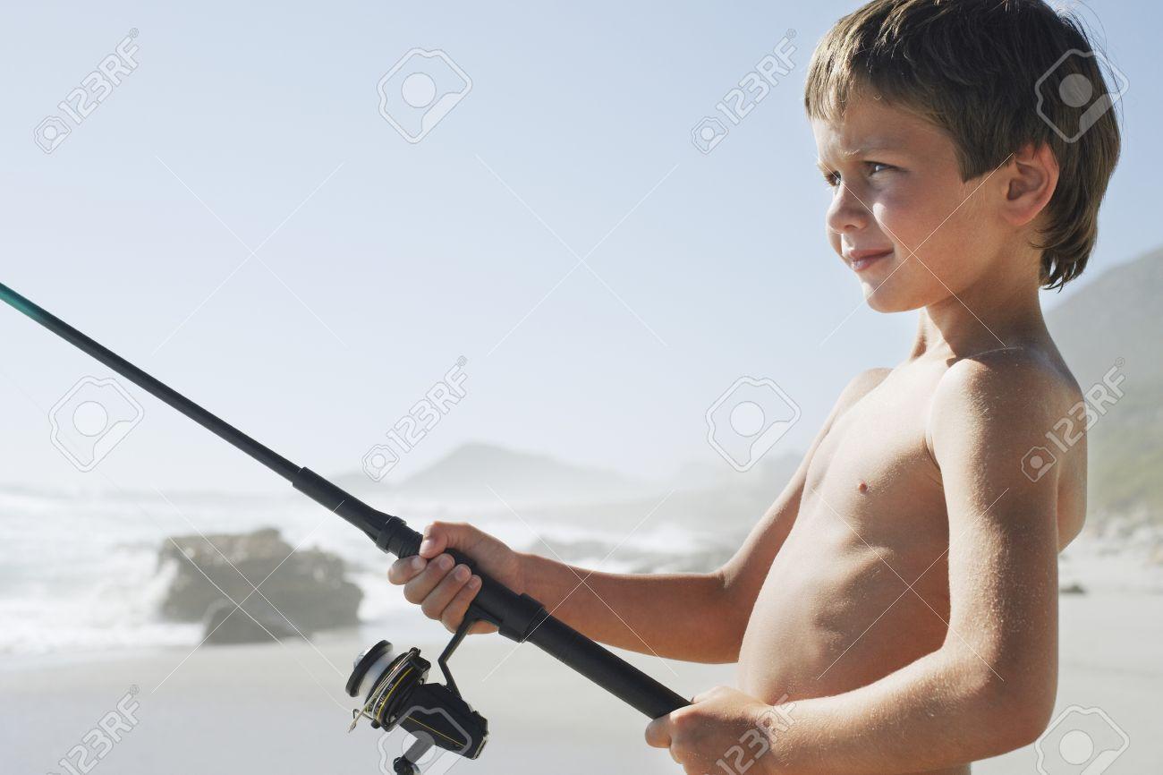 Boy Fishing on Beach Stock Photo - 12514268