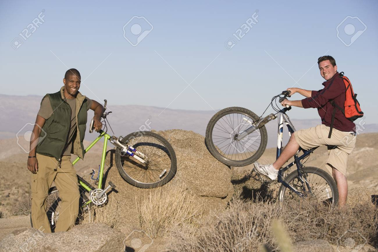 Young men stand with mountain bikes Stock Photo - 12547758