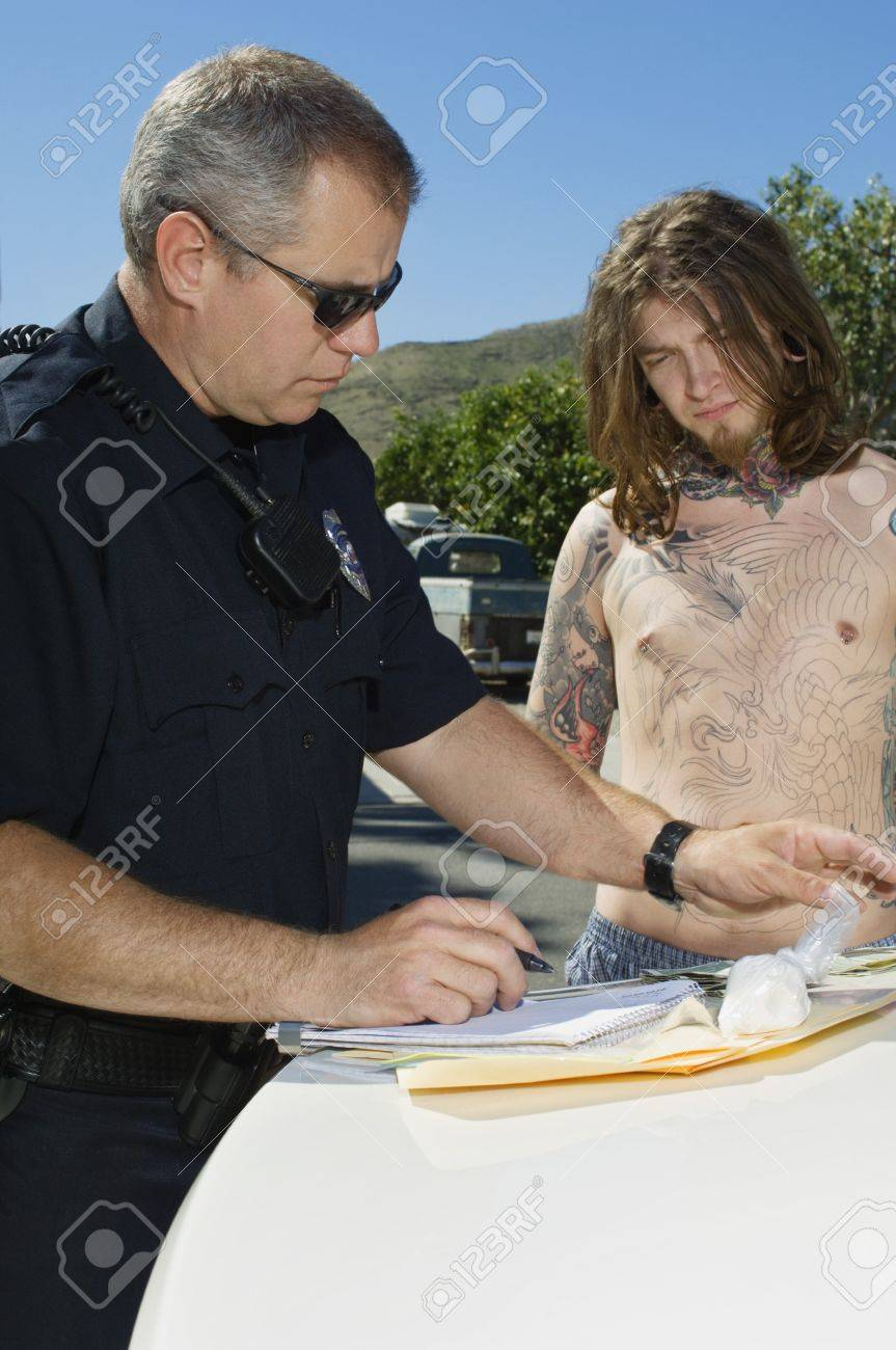 Police Officer Arresting Young Man Stock Photo - 12548028