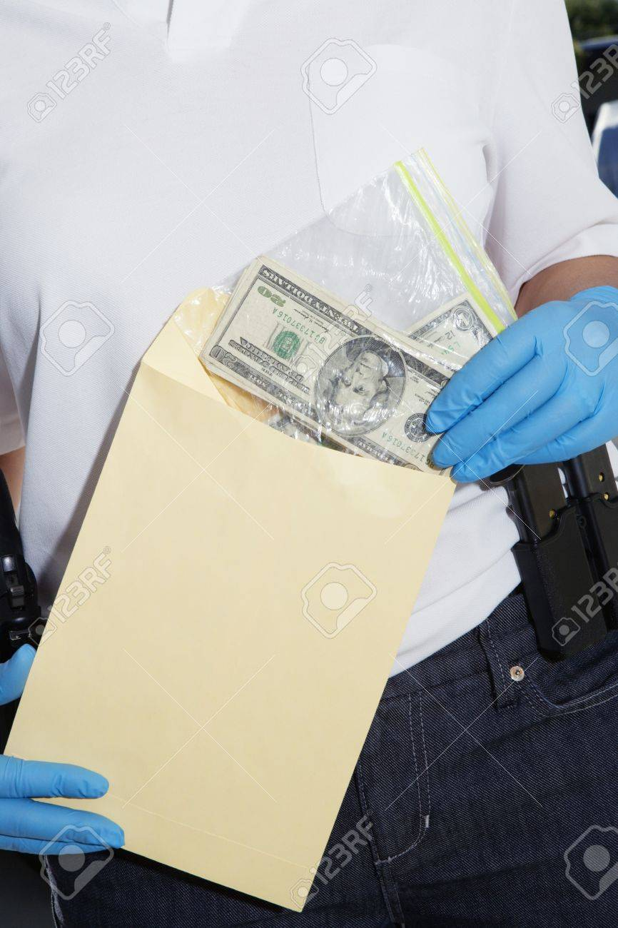 Police Officer Putting Money in Evidence Envelope Stock Photo - 12548094