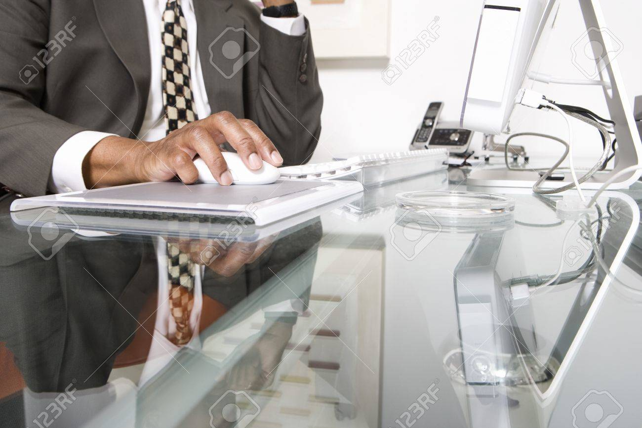 Businessman Using a Mouse Stock Photo - 12548151
