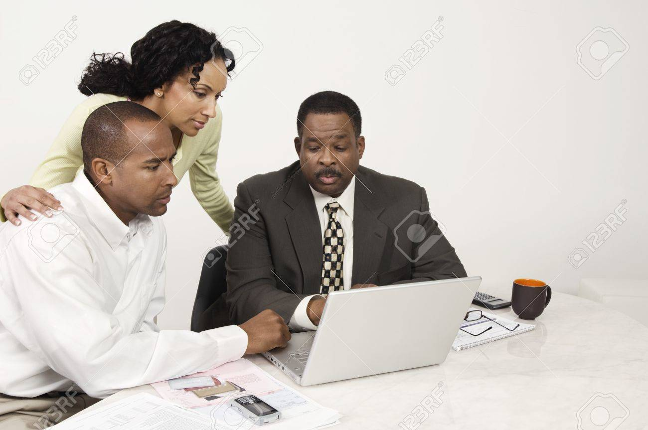 Couple and Accountant Using Laptop Stock Photo - 12548342