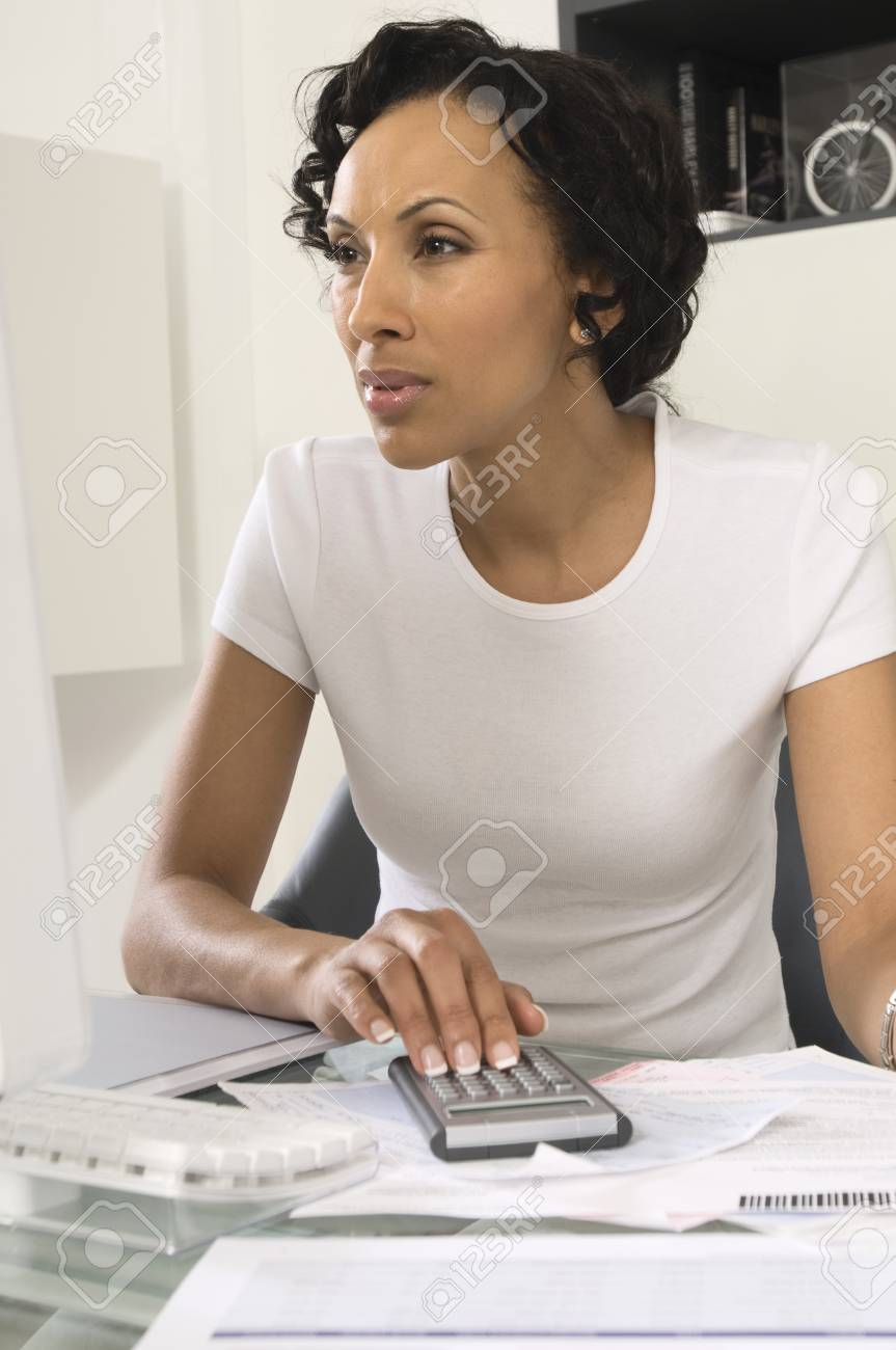 Woman Figuring out Personal Finances Stock Photo - 12548379