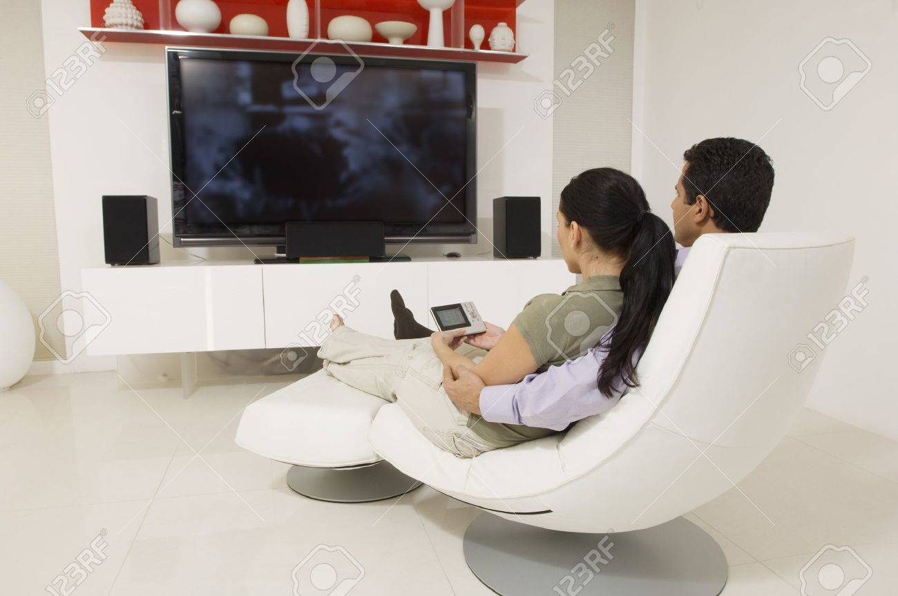 Couple Watching TV - 12548439