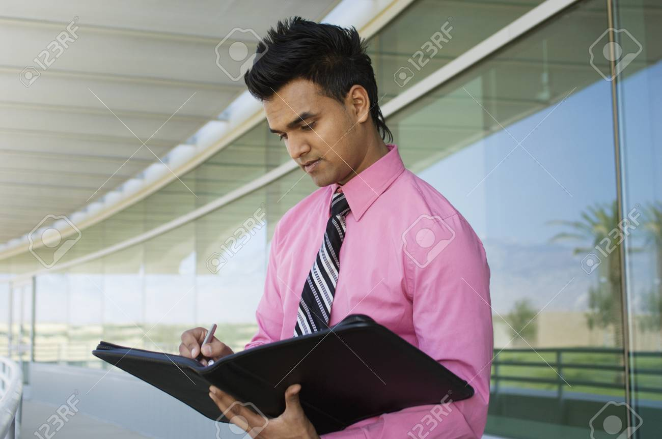 Businessman Writing in a Planner Stock Photo - 12548476