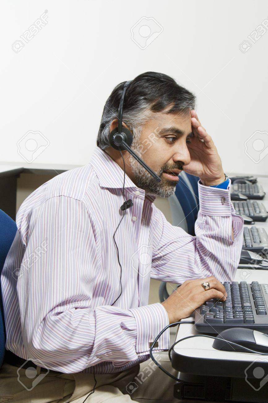 Businessman Using Telephone Headset Stock Photo - 12592367
