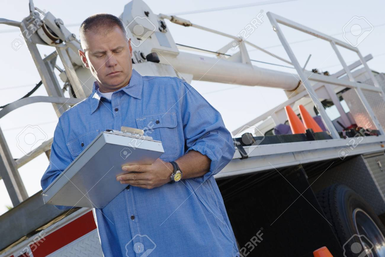 Mid-adult mechanic at work Stock Photo - 12592591
