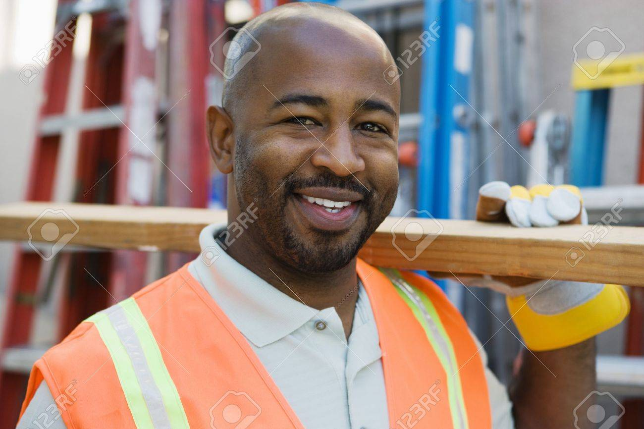 Workman with a Two-by-Four Stock Photo - 12592609