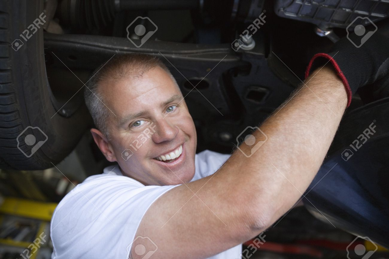 Auto Mechanic Working on Car Stock Photo - 12592671