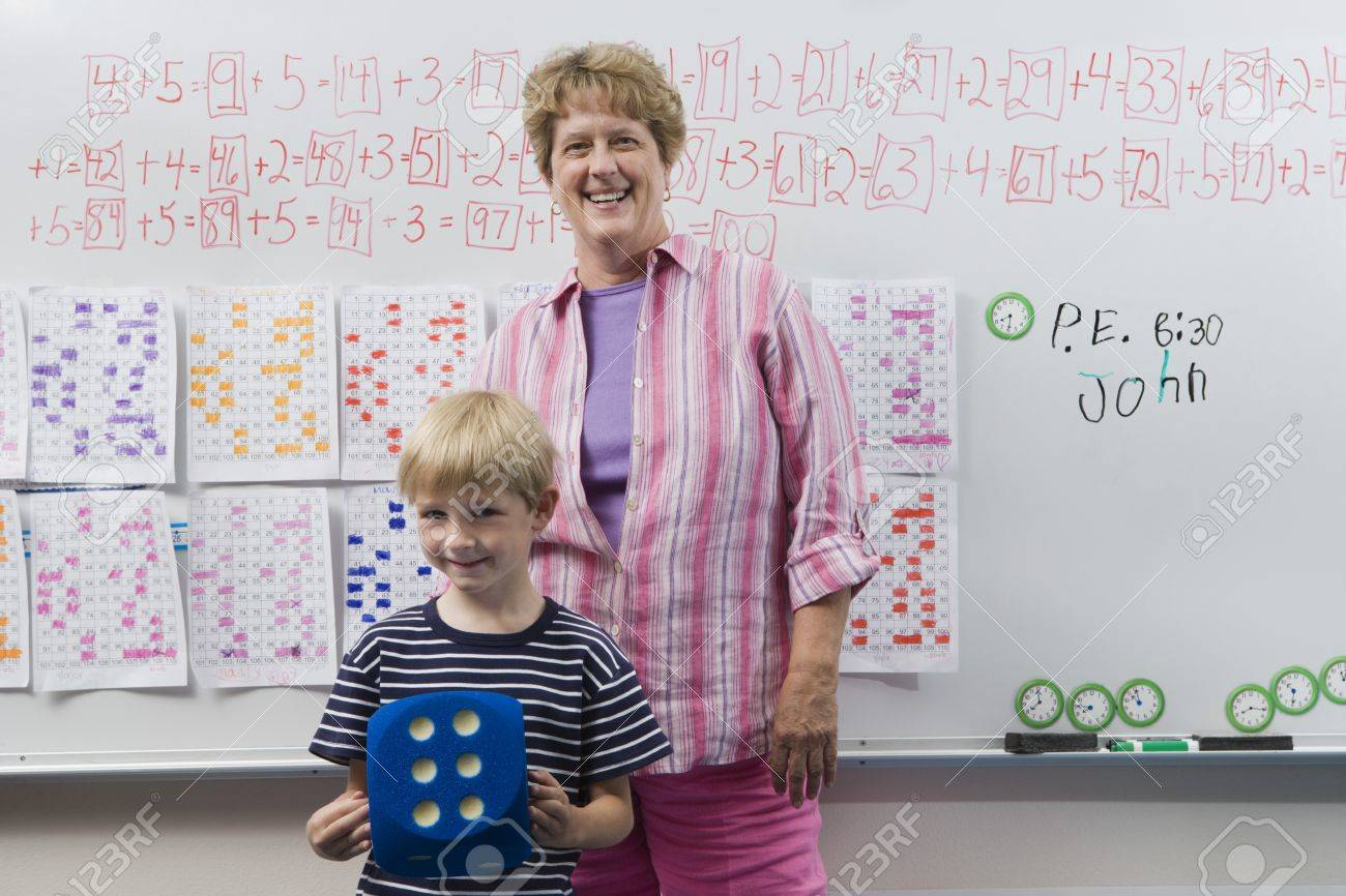 Teacher and Little Boy in Front of Class Stock Photo - 12592685