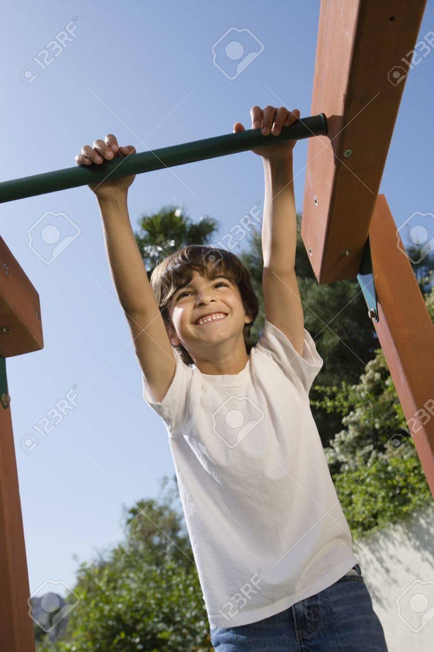 Little Boy on a Jungle Gym Stock Photo - 12592700