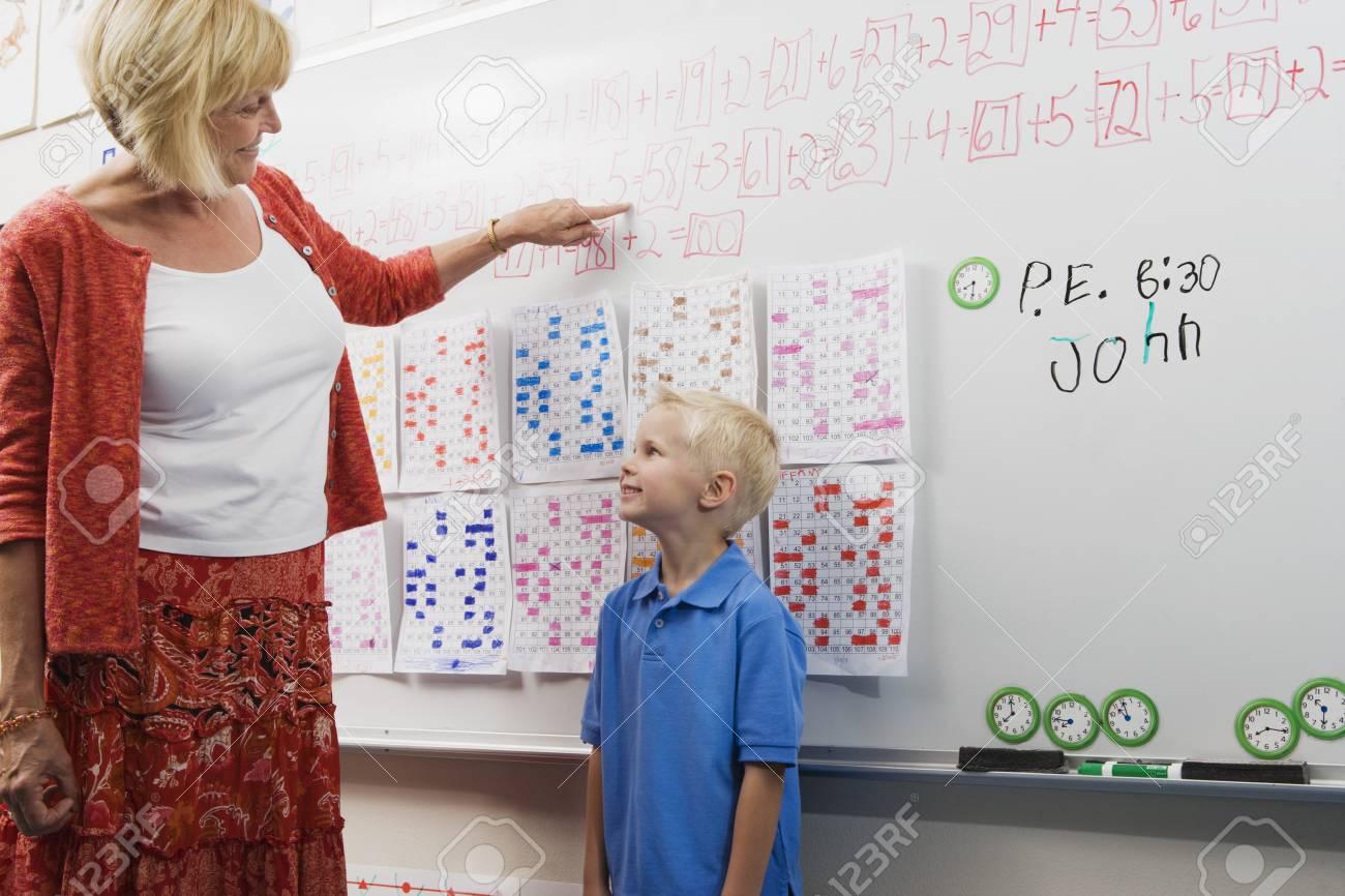 Teacher Talking with Little Boy Stock Photo - 12592708