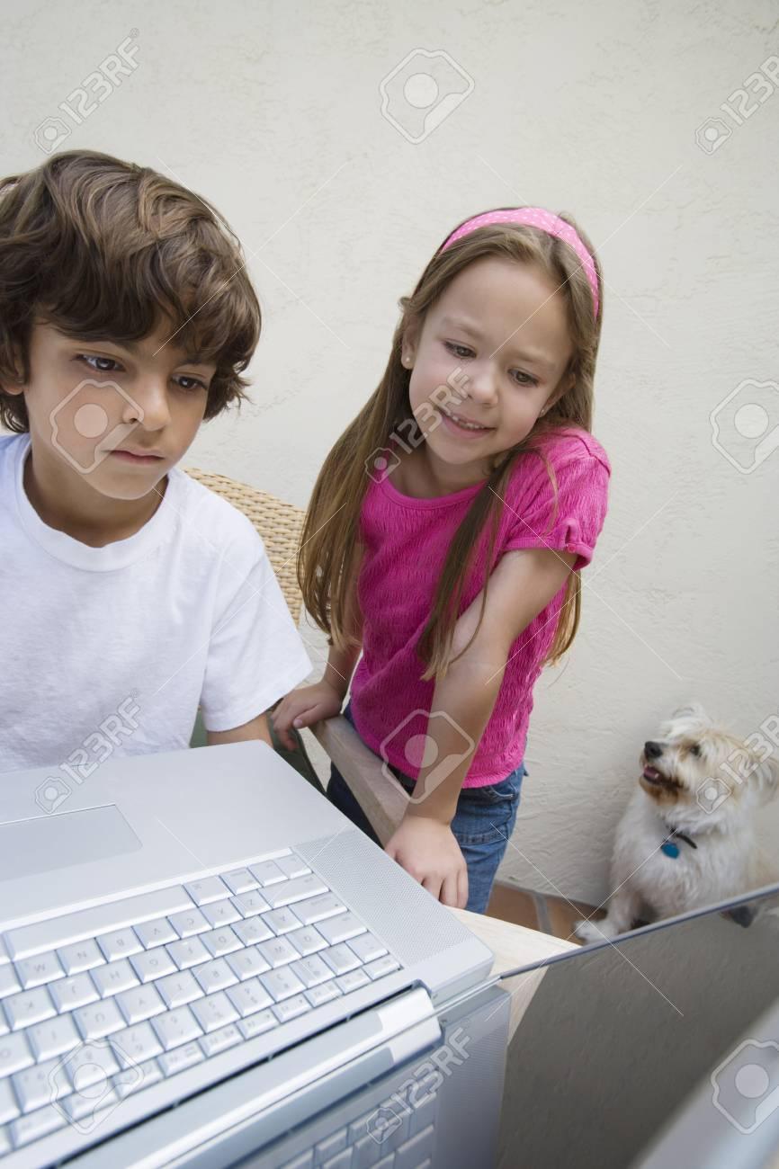 Little Kids Using a Laptop Stock Photo - 12592764