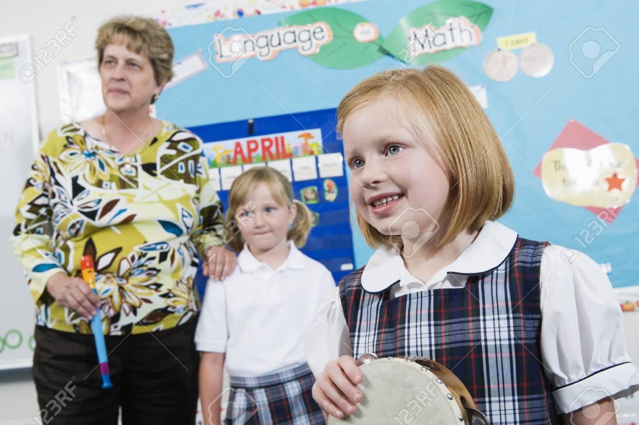 Elementary Student with Tambourine in Music Class Stock Photo - 12592864