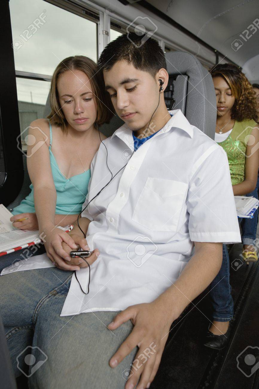 Teenagers Listening to MP3 Player While Riding School Bus Stock Photo - 12736390