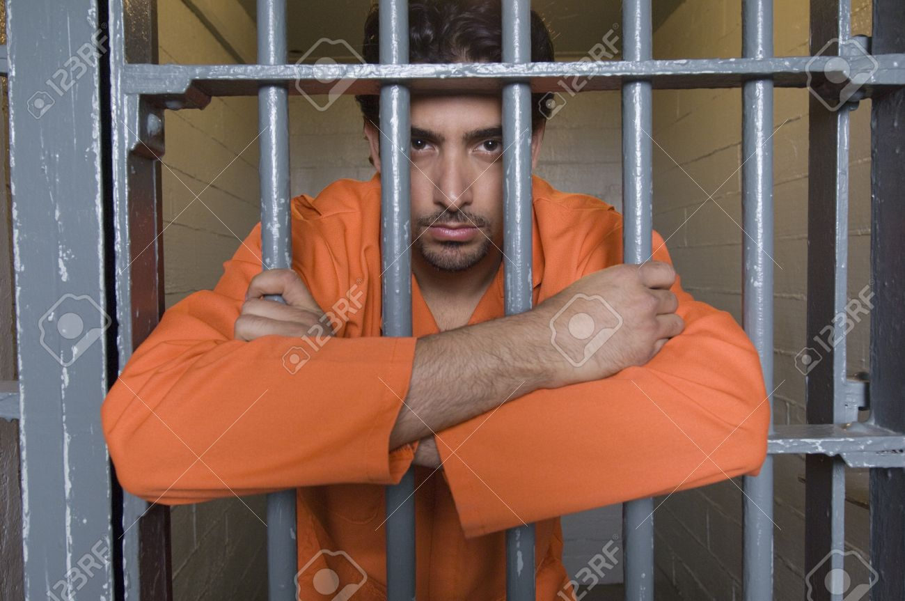 12736465-Portrait-of-prisoner-behind-bar