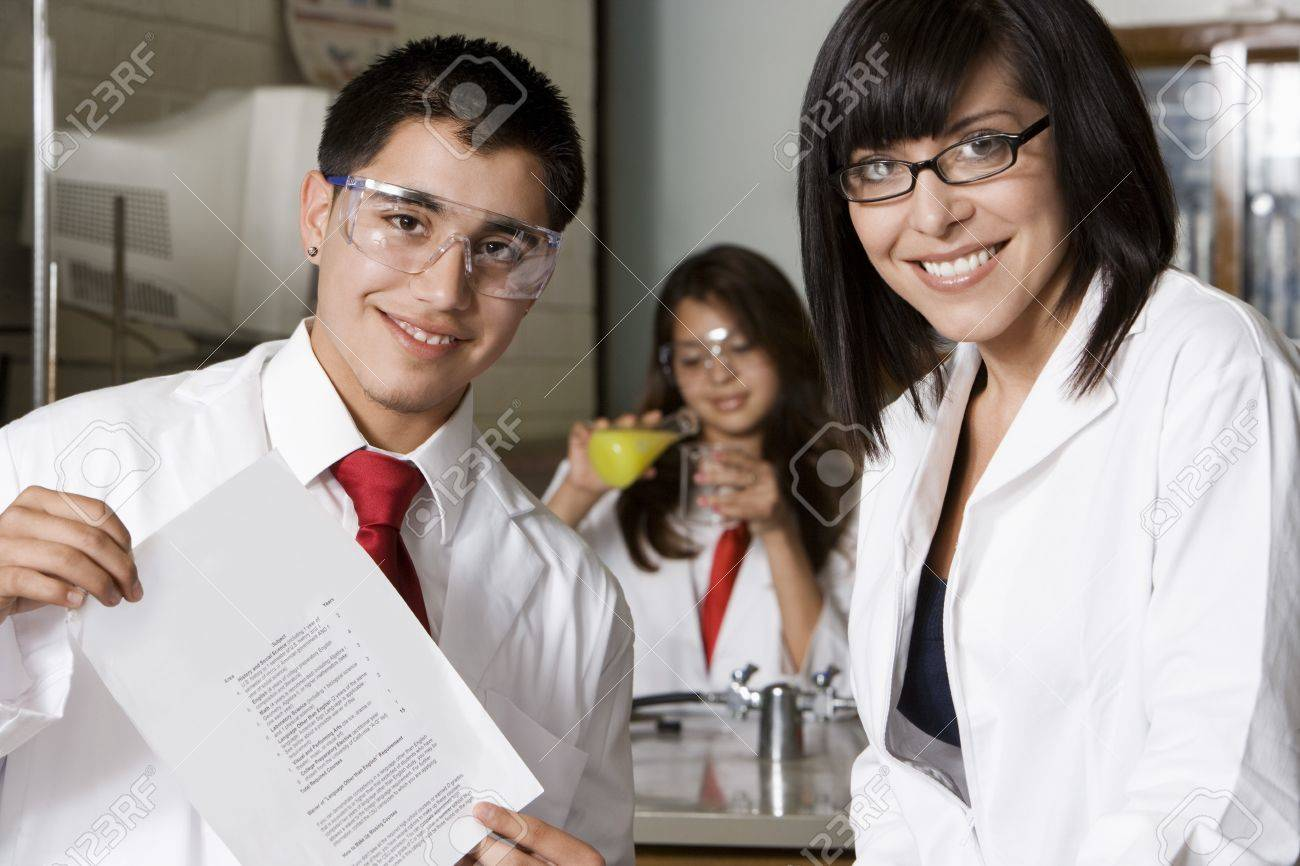 High School Student Holding Curriculum Paper Stock Photo - 12736808
