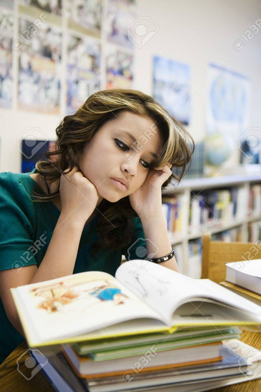 High School Student Reading in Library Stock Photo - 12736822