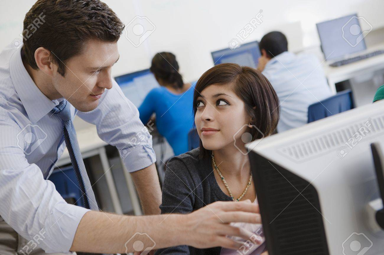 Teacher Helping Student in Computer Lab Stock Photo - 12736850