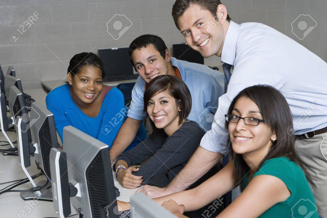 Teacher and Students in Computer Lab Stock Photo - 12736856