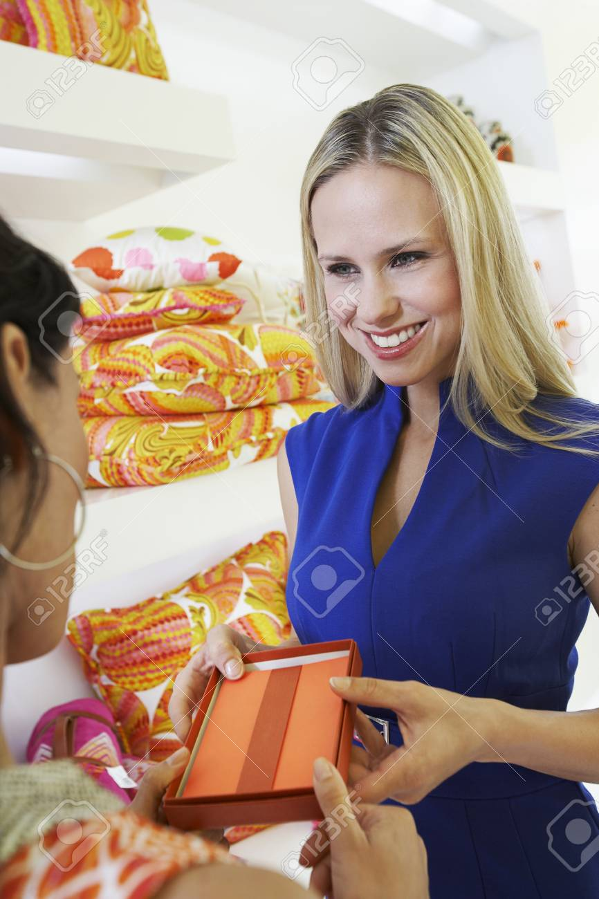 Young Woman Making a Purchase Stock Photo - 12736902