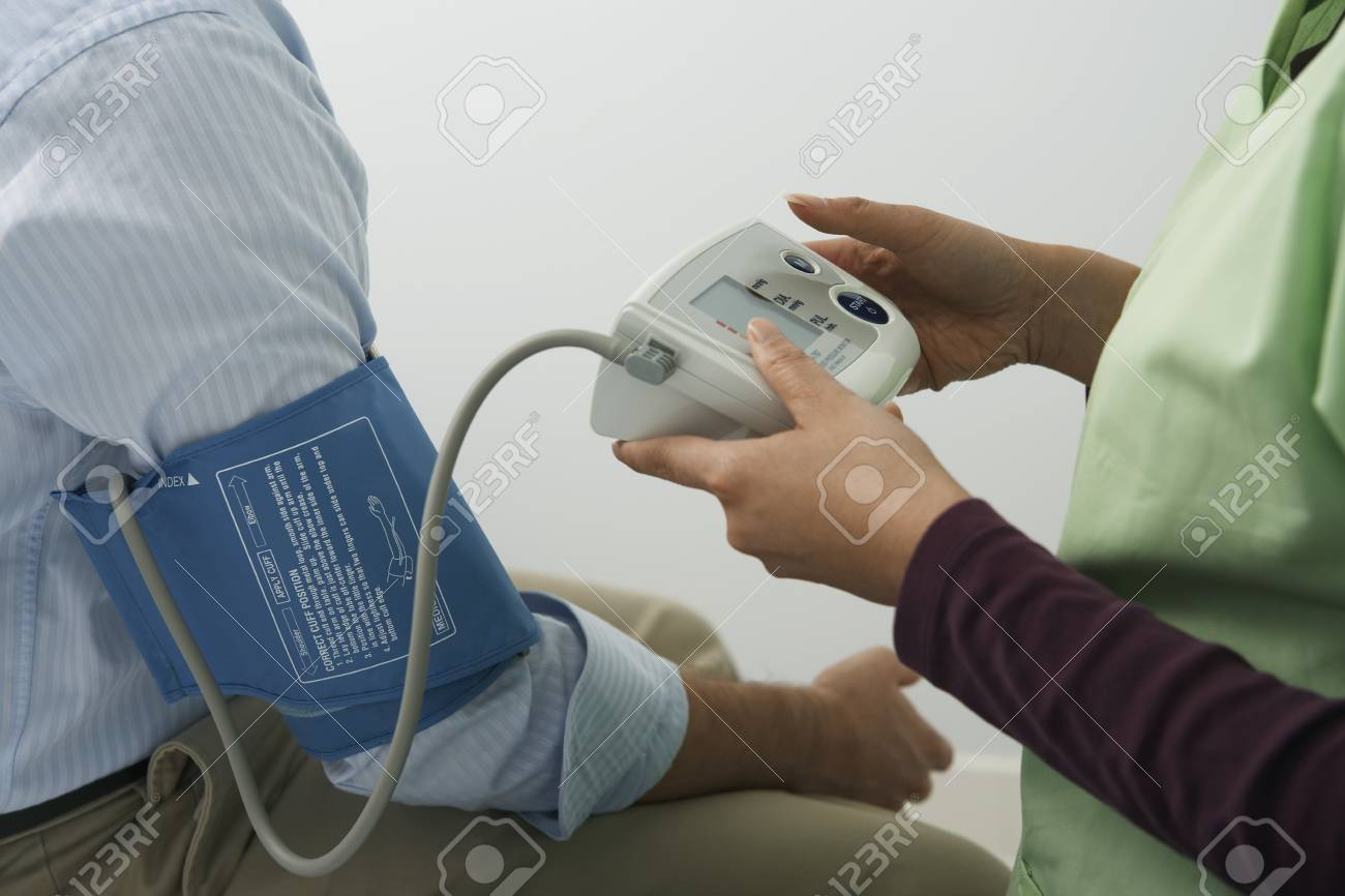 Doctor checking patients blood pressureclose-up Stock Photo - 12737420