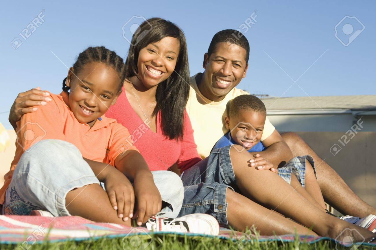 Family sitting on grass Stock Photo - 12737546