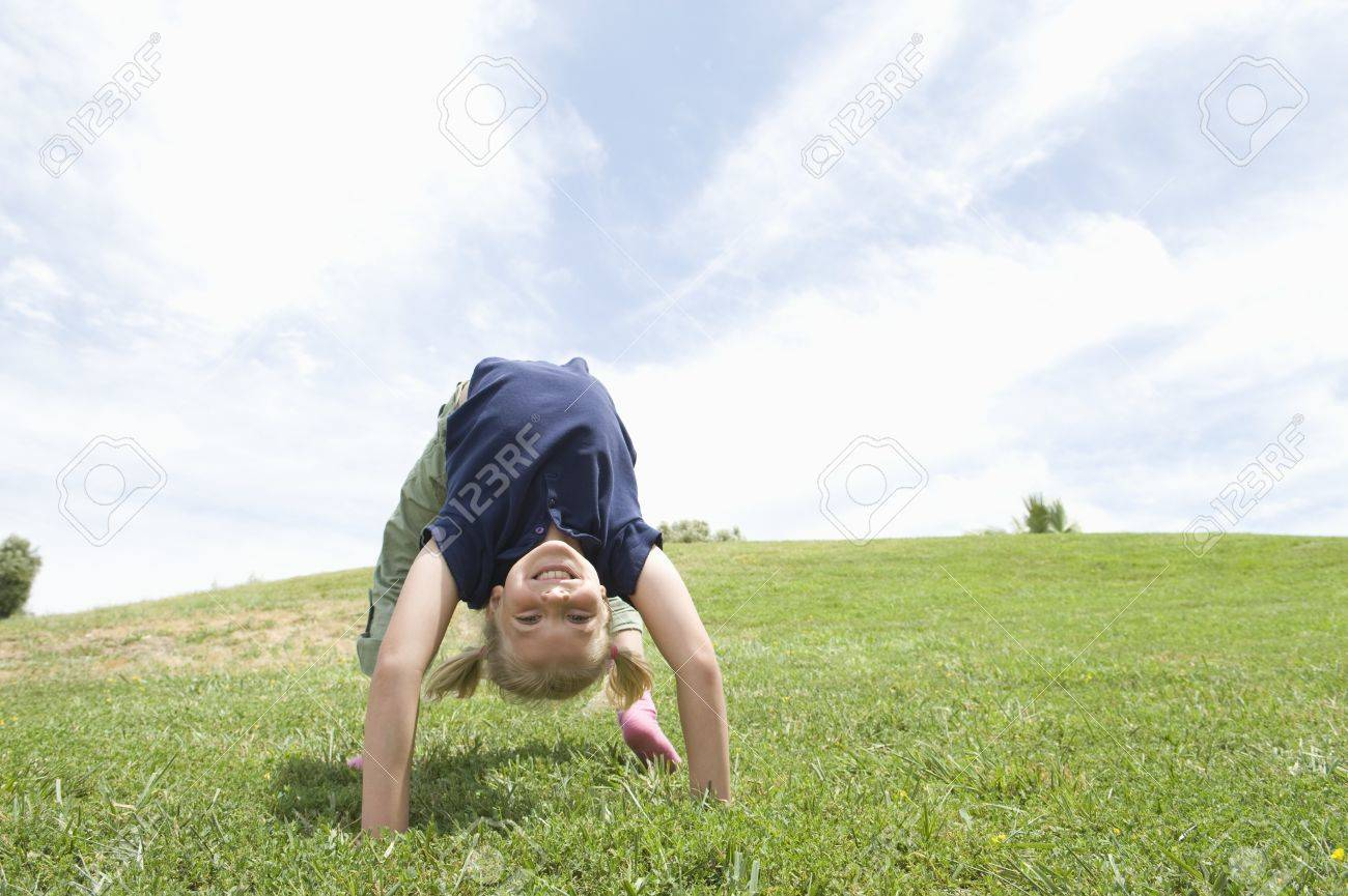 Bending over backwards girl on grass Stock Photo - 12737625