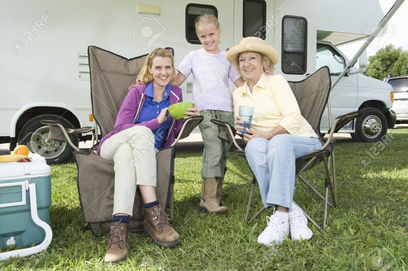 Mother daughter and grand daughter sit outside RV home Stock Photo - 12737631