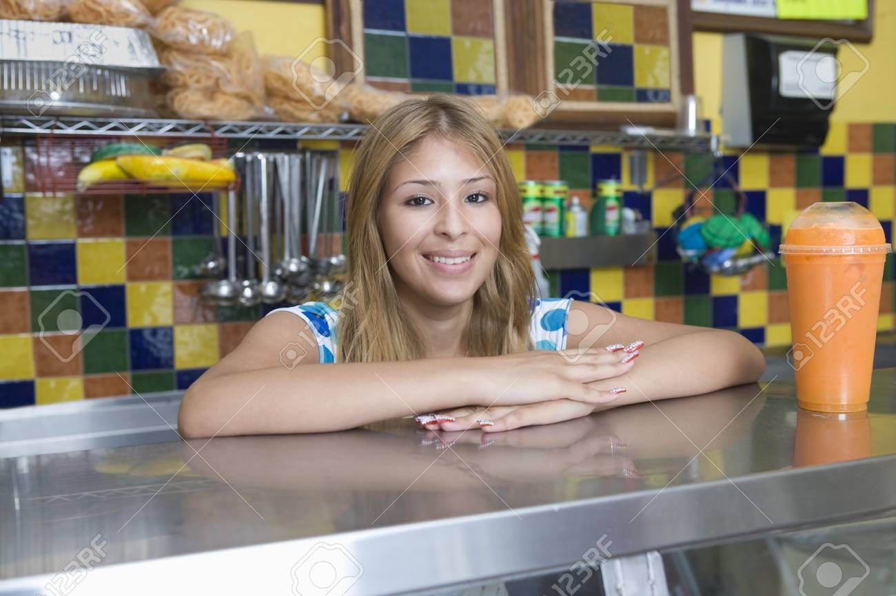 Portrait of young woman working in diner Stock Photo - 12735614