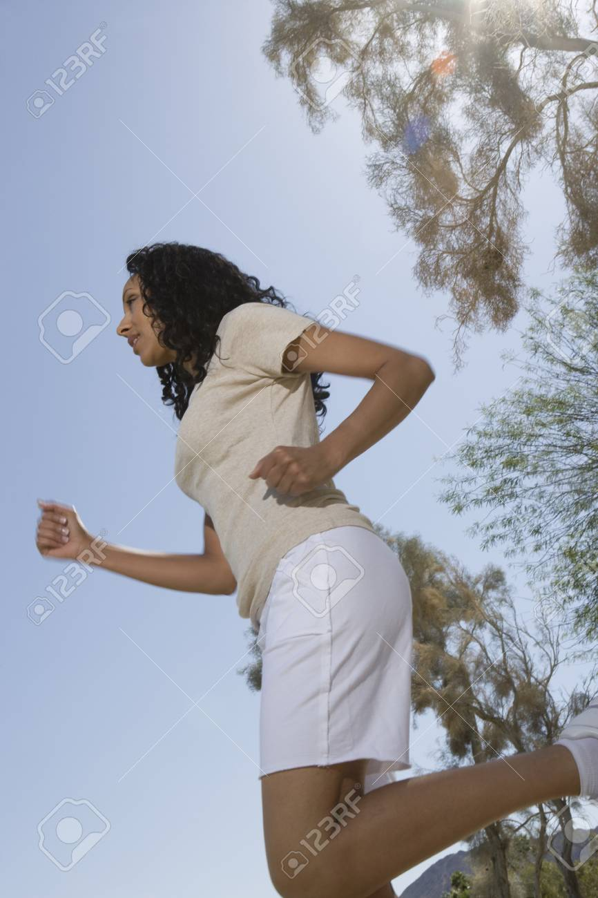 Mid adult woman jogging sideview Stock Photo - 12735647