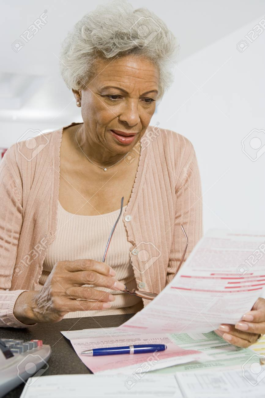 Senior Woman Studying Home Finances Stock Photo - 12735388