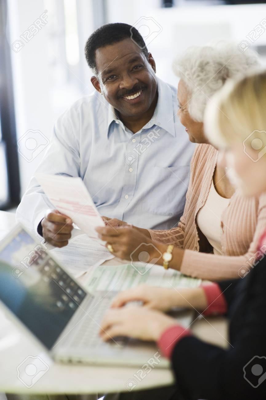 Financial Advisor Assisting Senior Couple Stock Photo - 12735363